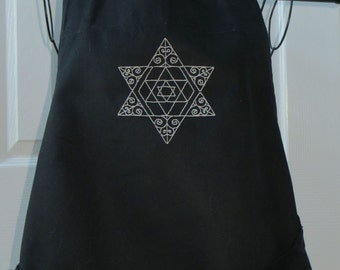 Black Apron with Star of David Embroidered in Silver Metallic Thread Apron was Purchased