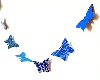 Blue garlands in paper butterflies
