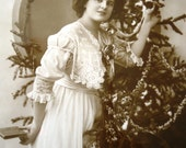 Antique Christmas postcard - Woman Edwardian lace dress, tree, black white tinted, glossy french, 1910