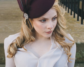 Elegant felt and feather percher hat for weddings/ the Melbourne Cup.