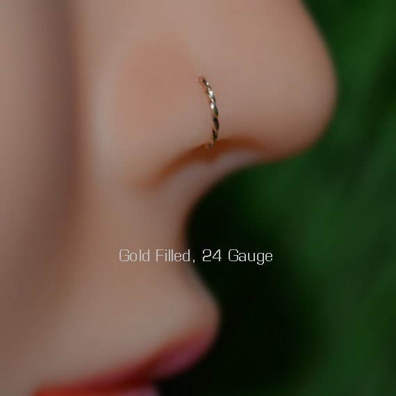 Comment mettre des boucles d'oreilles anneaux