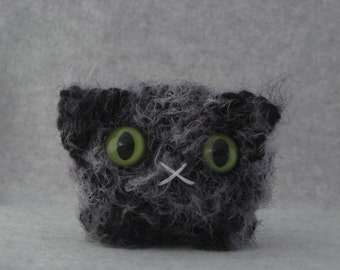 Crocheted charcoal grey plush kitty
