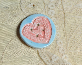Heart button pink and blue.....she is a sew on button