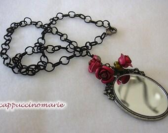 Mirror, Mirror.  Vampire test necklace.