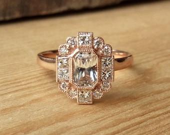 Emerald Cut Sapphire and Diamond Halo Ring