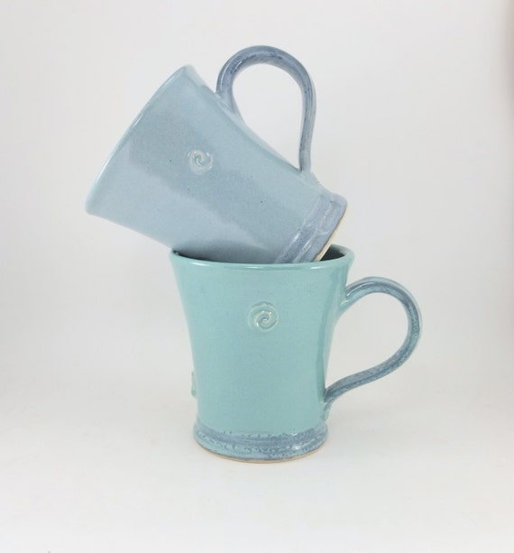 pair of blue and green mugs