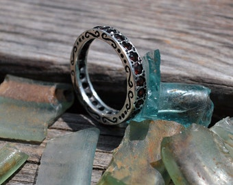 Garnet ring .sterling silver setting with garnet stones .