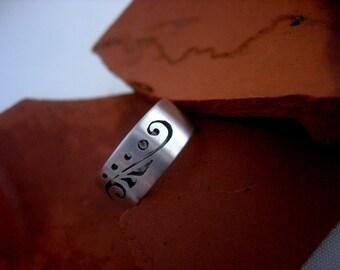Illuminated Manuscript Band Ring.  Hand cut sterling silver.
