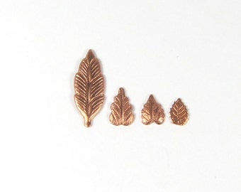 Feather Leaf in rosey  copper 21mm x 7mm inch set of 15 has a slight curve