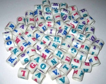 Vintage Round Plastic Scrabble Overturn Game Pieces or Cylinders with Colored Letters Set of 75