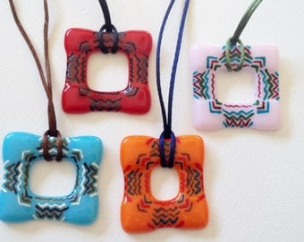Orange Fused Glass Hand Painted in an Aztec Design on Nylon Cord