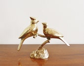 Vintage standing brass birds on a twig