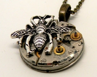 Steampunk jewelry. Steampunk watch with bee pendant necklace.
