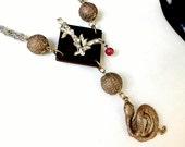 Rebel in the Garden assemblage necklace . vintage coiled mythological serpent eve eden apple, Lilith gothic art statement,  letter L, ooak