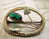Delicate vintage floral pin with green stone