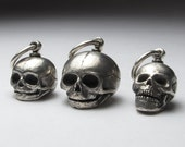 reserved for Jes sterling silver skull embryo small