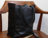 Repurposed leather and suede tote bag. Tall and narrow in black with dark brown sides.