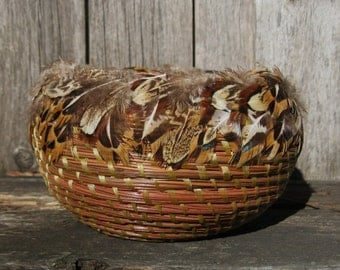 Coiled Pine Needle Basket with pheasant feathers