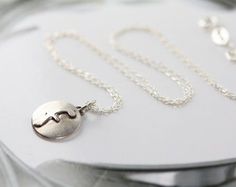 "Small lowercase inital letter ""f"". Sterling silver disc necklace handmade by Norita Designs"