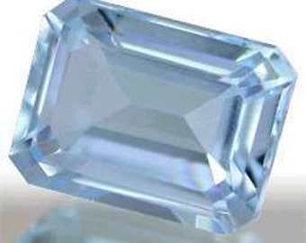 item #49 ~ one 8x6mm Emerald cut  Faceted ~ Genuine ~ Sky Blue Topaz ~ with certificate of authenticity ~  FDK