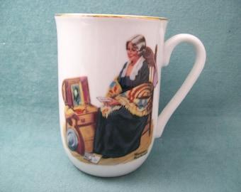 "Porcelain Mug, ""Memories"" story Mug by Norman Rockwell, 4"" tall, gold trim"