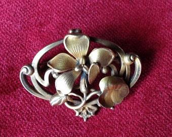 Fix, gold plated art nouveau floral brooch
