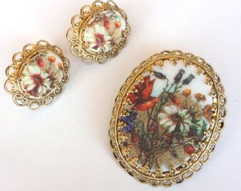 Vintage West Germany gold filigree brooch and clip on earrings set with floral cameo