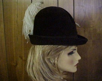 "Brown imported fur derby-fedora  hat with white emu feather- designer label ""Duby"" New York- 21-22 inches"