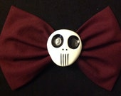 Large maroon skull fabric bow