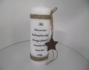 Pillar memory candle with the shabby chic look with a vintage rusty star