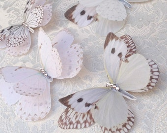 Silk Butterfly hair clips with Swarovski Crystals, delicate and fluttery in shades of cream and ivory.