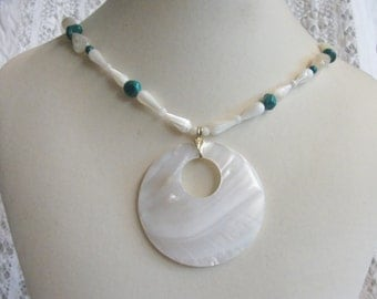 Mother of pearl shell pendant with turquoise pebbles necklace