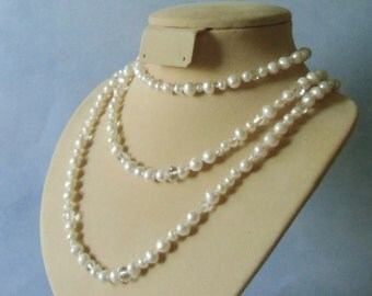 White fresh water pearls, sterling silver beads, and glass, silk cord,  hand knotted continuous necklace. 124 cm / 48.8'' long