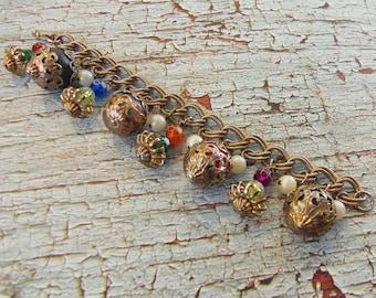 Chunky Gold Tone Filligree Capped Lucite Ball Charm Bracelet