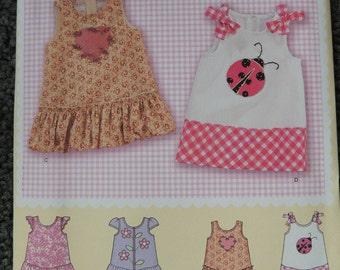 Simplicity 2235 Babie's Dress with Trim Variations (uncut) in sizes xxs-xs-m-L