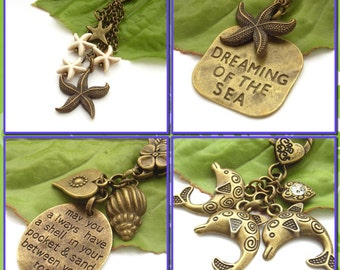 Sea beach seaside vacation holiday themed bag or purse charms with stamped words Dreaming of the Sea starfish dolphin shell crystal heart