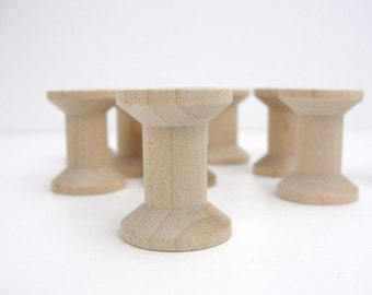 "12 Wooden spools 1 1/8"" tall"