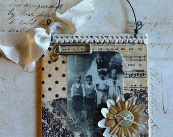 Vintage photo of four children featured in mixed media 4x4 canvas collage