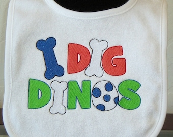 """Baby bib. Gifts for baby. Baby shower gift. Embroidery. Infant Embroidered White Baby Bib- Dinosaurs- with saying """"I dig dinos"""" KBD20148"""