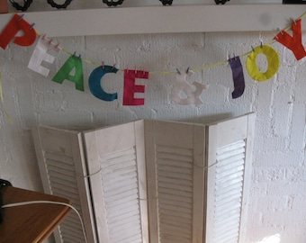 "Express your feelings of ""Peace and Joy"" with this banner."
