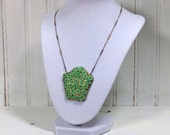 1950s lime green celluloid flower necklace shield shape delicate chain