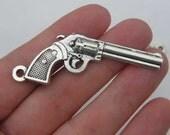 2 Gun pendants antique silver tone G10