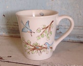 Bluebird family hand-painted mug. Sweet nesting blue bird illustrated ceramic cup.