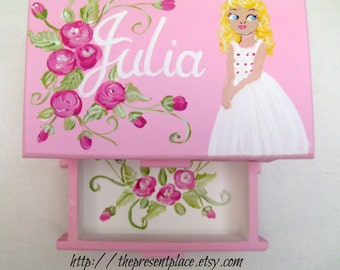 A jewelry box gift for a flower girl, complete with the dress she will wear.Personalized as a special thank you gift for a flower girl