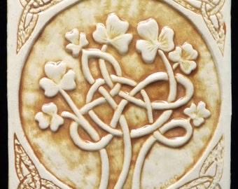 Decorative, relief carved ceramic Celtic shamrock tile