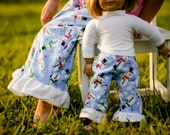 Christmas pajamas.Matching Girl and Doll Clothes. American Girl Matching Pajama Pant Set for Girl and Doll. Snowman print