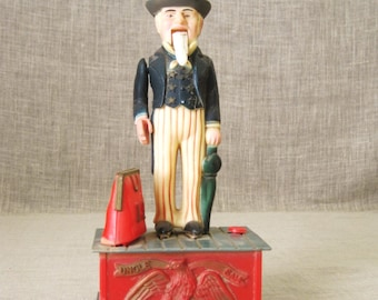 Coin Bank , Uncle Sam , Male Figure , Male Portrait , Money Bank , Mechanical Bank , Plastic Coin Bank , Patriotic Toy , Political Toy