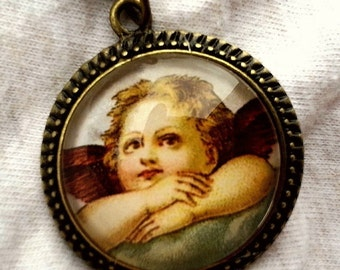 CLEARANCE  Cherub Glass Cameo Pendant in Antique Brass Setting with chain