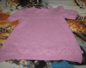 hand knitted pink babys dress