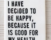 porcelain wall tag screenprinted text i have decided to be happy, because it is good for my health. -voltaire